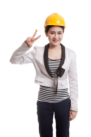 victory sign: Asian engineer woman show Victory sign  isolated on white background.