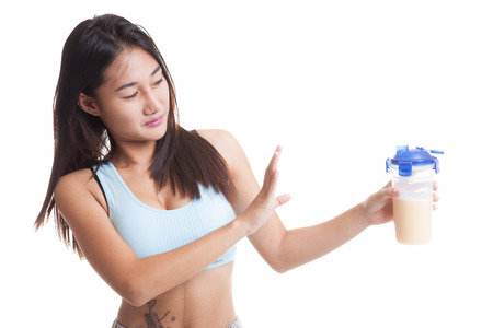 Beautiful Asian healthy girl hate whey protein  isolated on white background. Reklamní fotografie