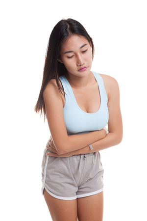 Asian healthy girl got stomachache  isolated on white background.