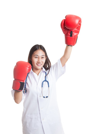fist pump: Young Asian female doctor win the fight   isolated on white background. Stock Photo