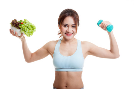 bcb27f559a Beautiful Asian healthy girl with dumbbell and salad isolated on white  background.