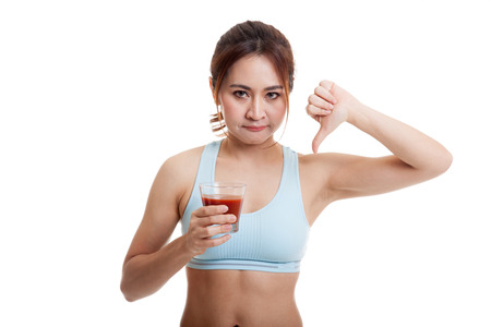 Beautiful healthy Asian girl hate tomato juice thumbs down  isolated on white background.