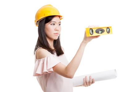 bubble level: Asian engineer woman with blueprints and level  isolated on white background.