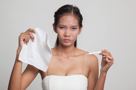 Young Asian woman got sick and flu  on gray background Stock Photo