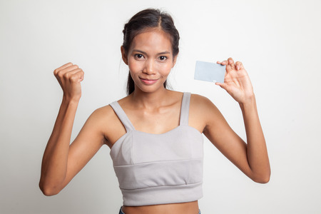 Young Asian woman fist pump with blank card on white background Stock Photo