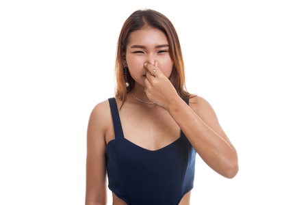 Young Asian woman  holding her nose because of a bad smell isolated on white background