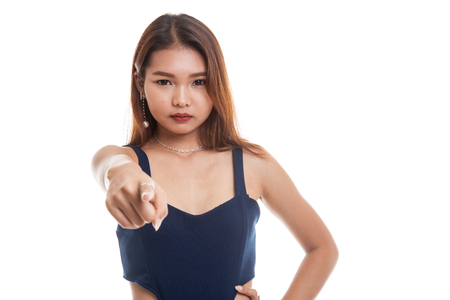 sulk: Young Asian woman angry and point to camera isolated on white background