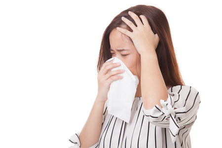 Young Asian woman got sick and flu isolated on white background Stock Photo