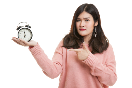 Angry young Asian woman point to a clock isolated on white background