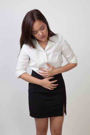 Young Asian woman got stomachache on white background Stock Photo