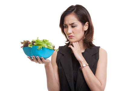 Asian woman hate salad isolated on white background Foto de archivo