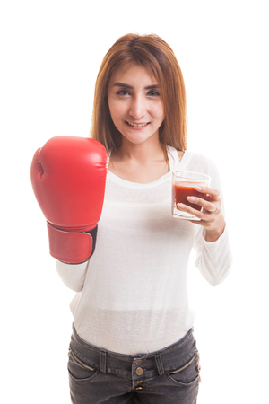 Young Asian woman with tomato juice and boxing glove  isolated on white background Stock Photo