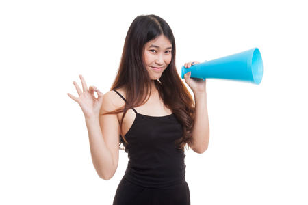 Beautiful young Asian woman show OK  announce with megaphone isolated on white background