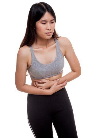 Asian healthy girl got stomachache isolated on white background