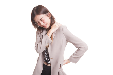 Young Asian woman got back pain isolated on white background Foto de archivo