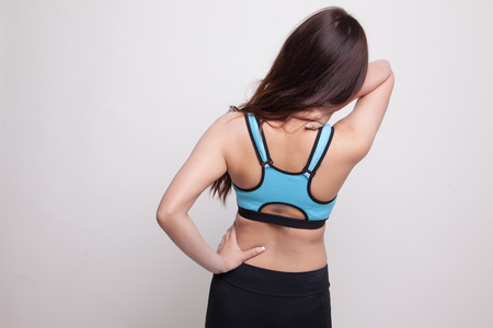 Asian healthy girl got neck pain and back pain on white background