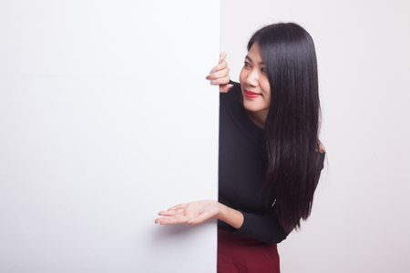 Young Asian woman present blank sign with palm hand on white background