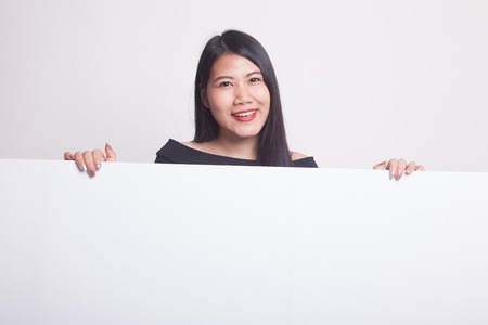 Young Asian woman with blank sign on white background