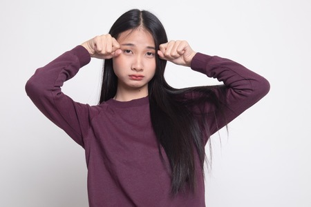 Young Asian woman sad and cry on white background Stock Photo