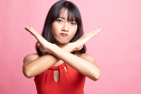 Beautiful young Asian woman say no on pink background Stock Photo