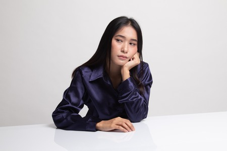 Asian girl is getting bore on white background