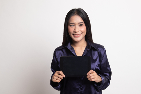Young Asian woman with a computer tablet on white background