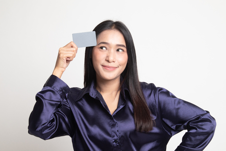 Young Asian woman think with a blank card on white background