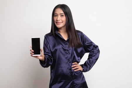 Young Asian woman with mobile phone on white background