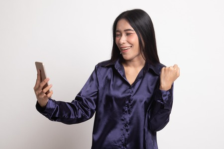 Successful young Asian woman with mobile phone on white background