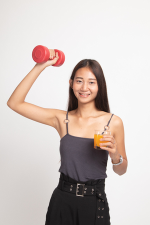 Young Asian woman with dumbbell drink orange juice on white background