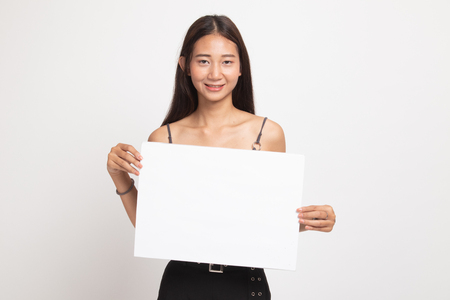 Young Asian woman with white blank sign on white background Stock Photo