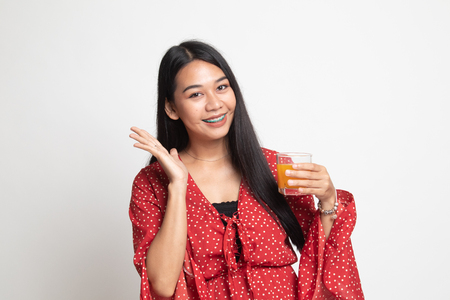 Happy Young Asian woman drink orange juice on white background