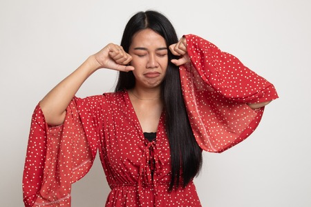 Young Asian woman sad and cry on white background
