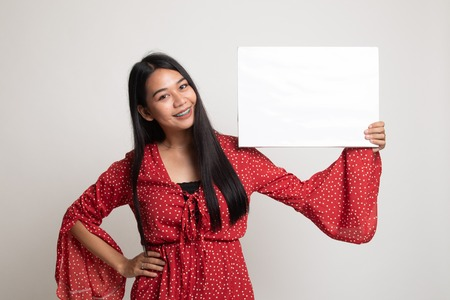Young Asian woman with white blank sign on white background