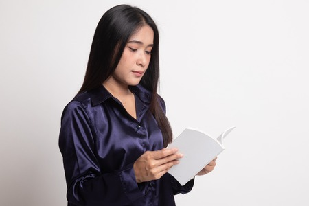 Young Asian woman read a book on white background