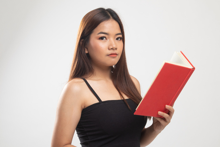 Young Asian woman read a book on white background Banco de Imagens - 122817109