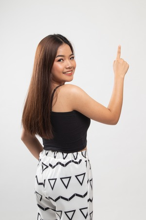 Back of Asian woman touching the screen with her finger on white background
