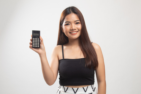Asian woman smile with calculator on white background