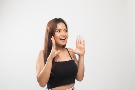 Young Asian woman is surprised and smile on white background Banco de Imagens