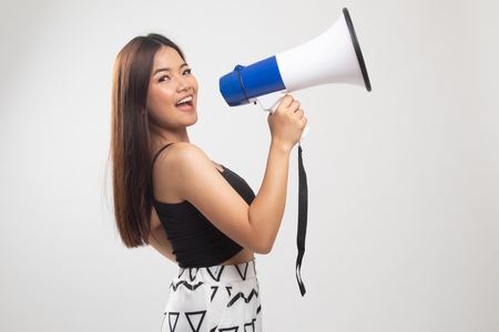 Beautiful young Asian woman announce with megaphone on white background