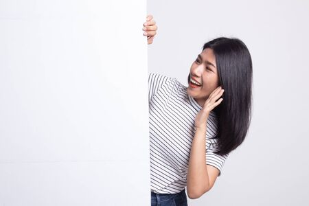 Excited young Asian woman with blank sign on white background 版權商用圖片