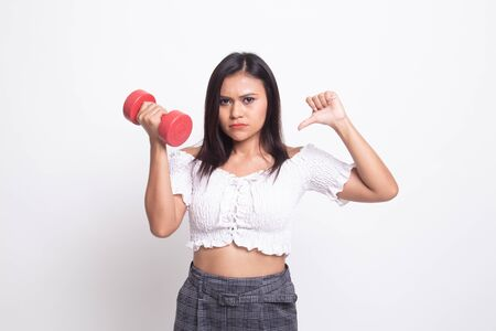 Unhappy Asian woman thumbs down with dumbbells on white background