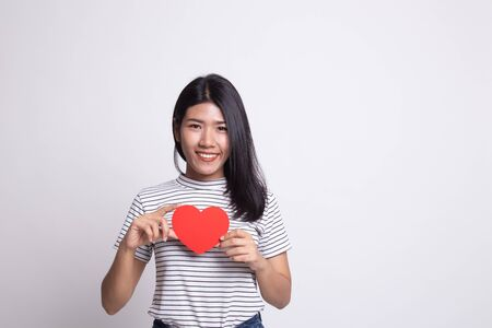 Asian woman with red heart on white background Stock Photo