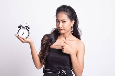 Angry young Asian woman point to a clock on white background Foto de archivo