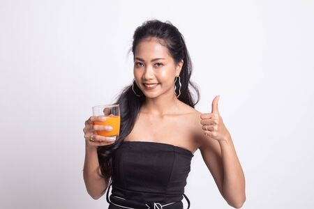 Young Asian woman thumbs up drink orange juice on white background