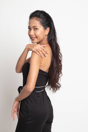 Happy Beautiful young Asian woman on white background 版權商用圖片