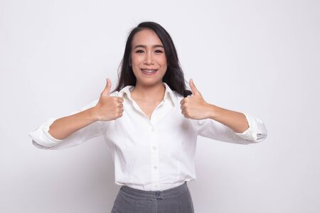 Young Asian woman show two thumbs up on white background