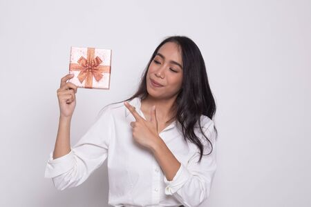 Young Asian woman with a gift box on white background