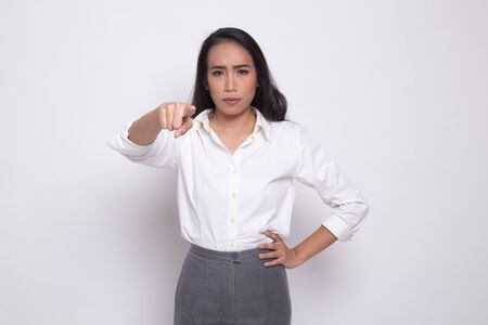 Young Asian woman angry and point to camera on white background