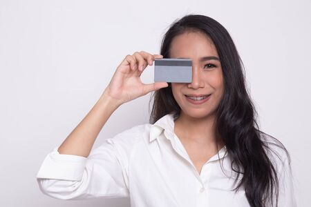 Young Asian woman with  blank card over her eye on white background